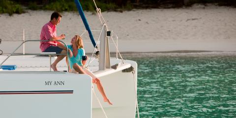 Couple relaxing on Moorings 4600