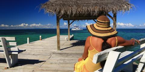 Woman overlooking beach on dock