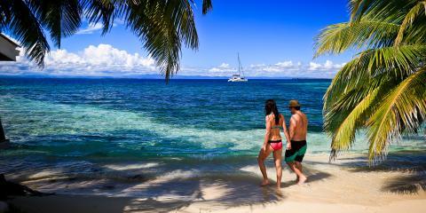Couple walking on beach in Belize