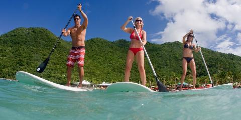 three people standup paddleboarding