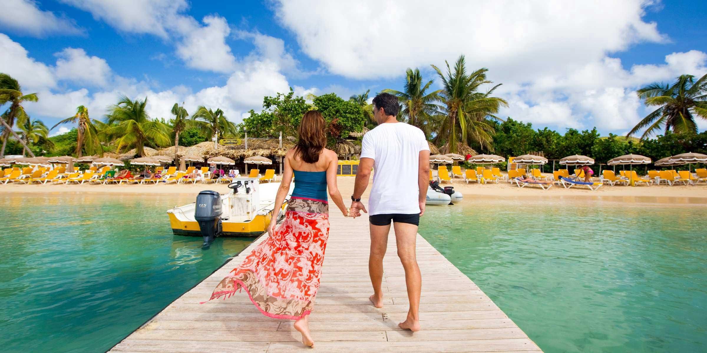 couple walking on pier in St. Martin